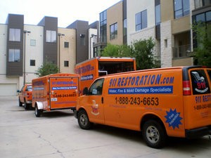 Snow Storm Remediation Vehicles At Commercial Job Site